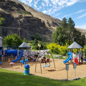 Colorful Playground with Swings and Roofs gallery thumbnail